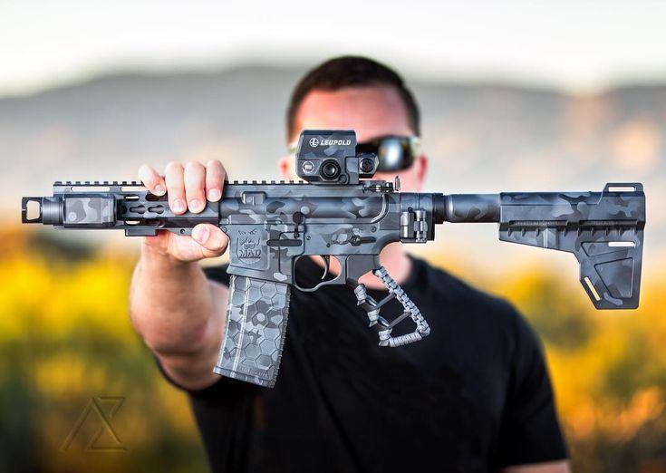 #cerakoteMADness MADLand Camo -- @az_photo_man -- My bro @skrillafox behind the @mad_custom_coating AR pistol.