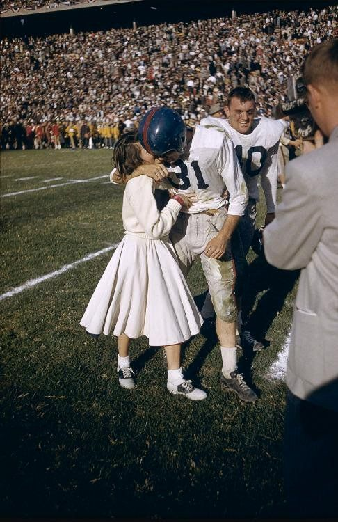 University of Mississippi plаyer being kissed by a cheerleader after the Cotton Bowl (1956)