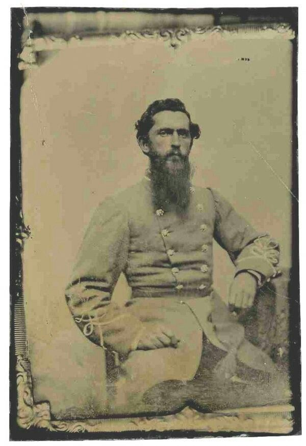 Tintype of a Confederate officer ambrotype. The long-bearded gentleman sits in a three-quarter pose, wearing the signature Confederate officerís frock coat with a double row of buttons. The single row of sleeve braid and single collar stripe identify the officer as a Second Lieutenant. Frame of original ambrotype visible at edges. Tintype was likely made of the more fragile ambrotype for greater portability. Images measures 2.5î x 3.75î. Fine condition.
