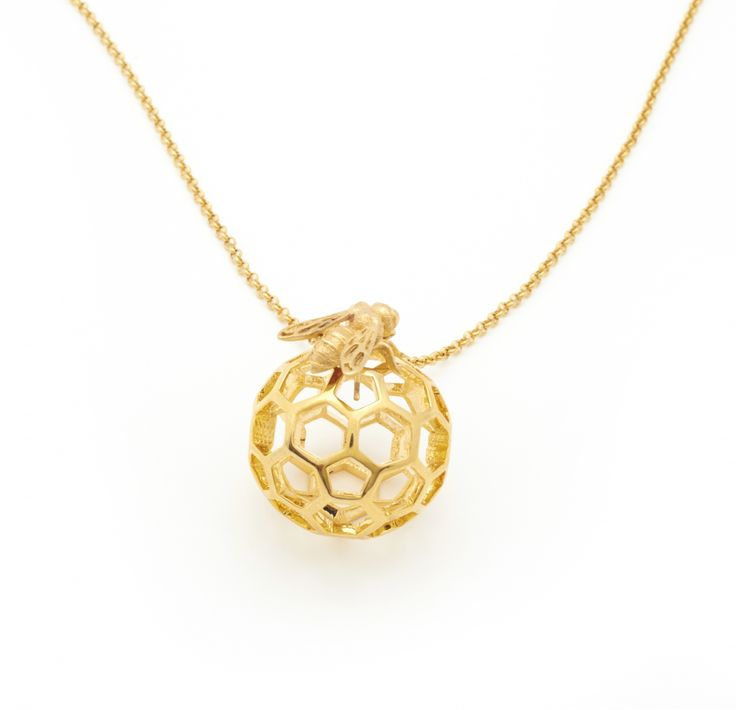 This striking pendant has quickly become a Bill Skinner classic. Beautifully carved and utterly unique the honey comb orb is suspended on a 80cm belcher chain with a 5cm extender.
