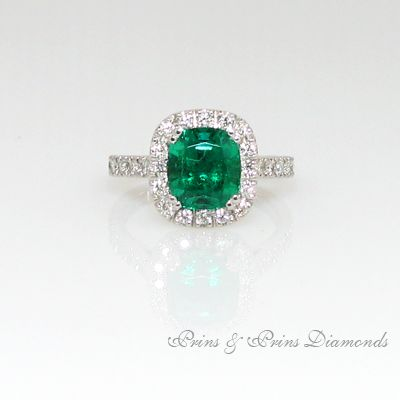 Radiant Emerald set with a diamond halo on Platinum ring