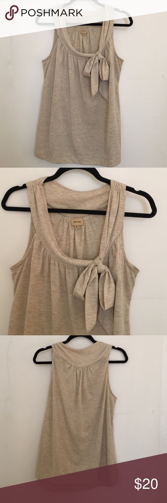 Anthropologie Sleeveless Bow Tie Blouse Charming blouse with elegant drapey neckline and bow. Loose fit. Material is soft heathered fabric in creamy oatmeal. Shows some very minor wear at the armpit and hem. From Anthro brand Ella Moss. Anthropologie Tops Blouses
