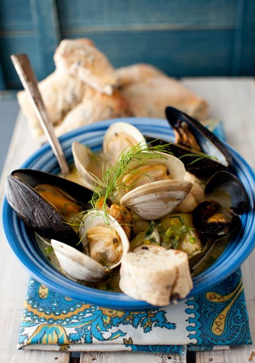 Mussels in white wine sauce with crusty bread is summer food.