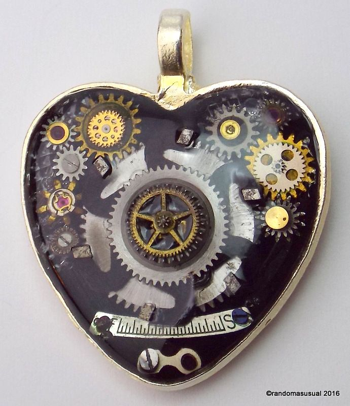"""April 6/16 - Experimenting with bas relief type techniques. Watch parts pendant! I call it """"My Mechanical Heart""""."""