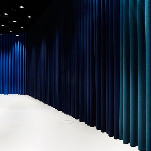 Curtains Going for lustrous midnight colours. Floor to ceiling curtains in Kvadrat's classic sculptural Divina wool at the Museum für Film und Fernsehen in Berlin.