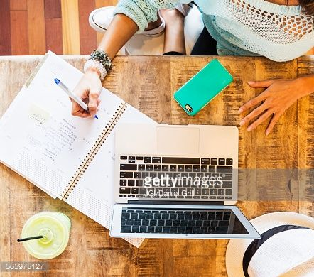 Stock Photo : Chinese woman studying with laptop in cafe