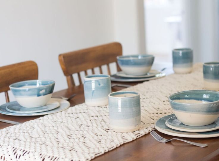Tide Dinner Set in gloss blue glaze that fades to the neutral clay color, a nod to the changing ocean tide.  Summertime sun and salt water air are the inspiration behind the Dock + Tide Collection.  Their minimalist design will integrate seamlessly into your home and add a little bit of joy to your everyday routine.