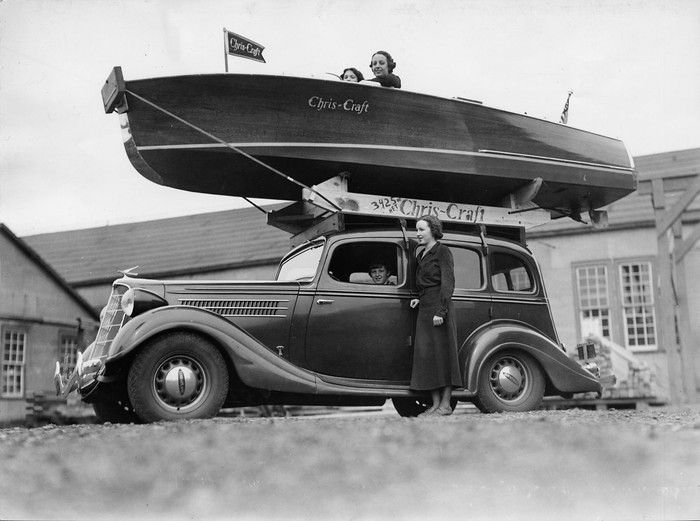 Vintage Chris-Craft. Easy to transport. Just remember the boat is on the car before pulling into the garage.