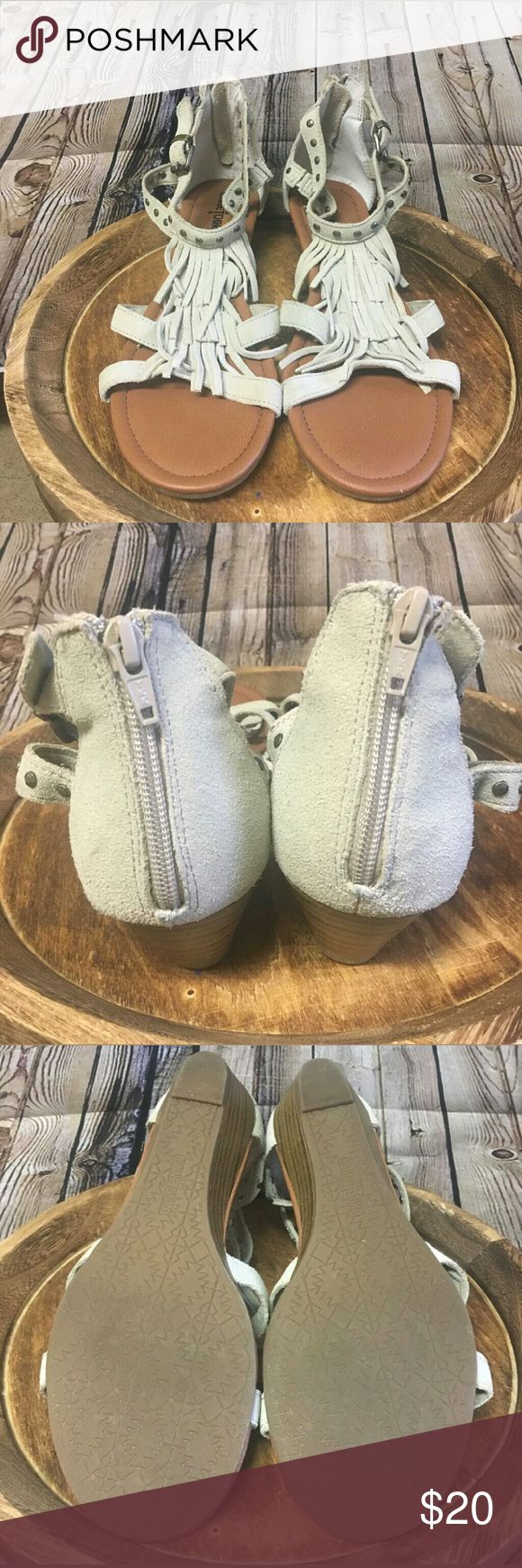 NWoT Minnetonka Fringed Suede Sandals Size 10 Brand new, only tried on Minnetonka Moccasins fringed suede leather sandals. Women's size 10. Grommets on ankle straps, zip back & buckles on ankles. Minnetonka Shoes Sandals