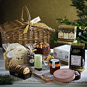 Bettys Luxury Christmas Hamper | Our Classic Christmas pudding and cake join a host of delights showing the skills of our bakers and confectioners, all housed in a willow hamper woven on the banks of Yorkshire's River Wharfe by a fourth generation craftsman.