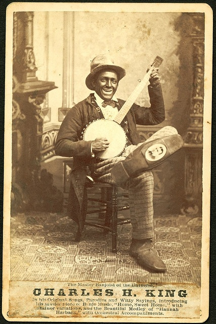 """1885 Minstrel Shows with whites performing in blackface and portraying blacks as foolish, ignorant and happy with their lot in life were at their height between 1850-1870. """"Blackface performers are...the filthy scum of white society, who have stolen from us a complexion denied them by nature, in which to make money, and pander to the corrupt taste of their white fellow citizens."""" Frederick Douglass"""