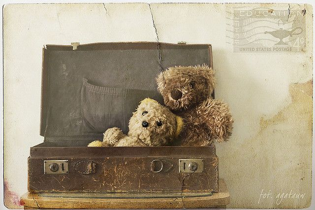 Old teddy bears & suitcase Aubrie (main character) finds in attic at Grace Bed & Breakfast in Stillwater Springs. Belonged to her mother, Valerie Jean Barwick - see picture of pink nursery. X: