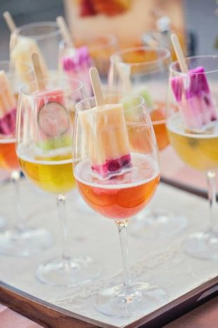 Serve popsicle spritzers during your wedding cocktail hour for a fun and cool treat! {Photo courtesy of Debbie Kennedy Events & Design}