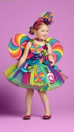 Candy Fairy Girls Costume. Know a little girl with a sweet tooth? This candy fairy girls costume is covered in tasty treats, including bright candies dangling around her fluffy tulle skirt. Sweeten her look with all the candy-coated accessories, especially the rainbow lollipop wings which are adorned with a shiny purple candy twist, and the wand (which is a real lollipop!). In this rare case, there's no such thing as too much sugar.
