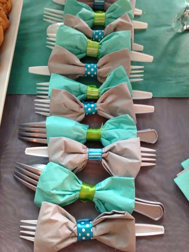 bow tie napkins ~ tie napkins together with ribbon so as to form your bow tie, matching your ribbon with the decor or party theme.