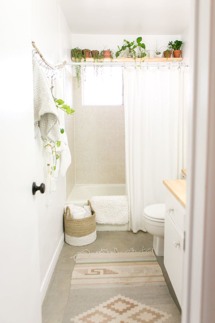 Love the shelf with plants over the shower!