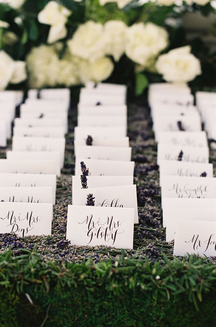 Escort Cards - Calligraphy  - http://www.StyleMePretty.com/2014/03/20/classic-white-wedding-at-bacara-resort/ Patrick Moyer Photography on #SMP