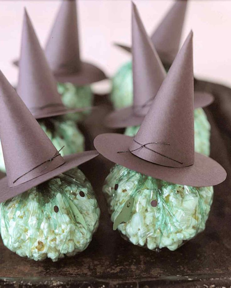 A band of plump, popcorn-filled witches swoops in to add a spirited spell to your Halloween festivities.