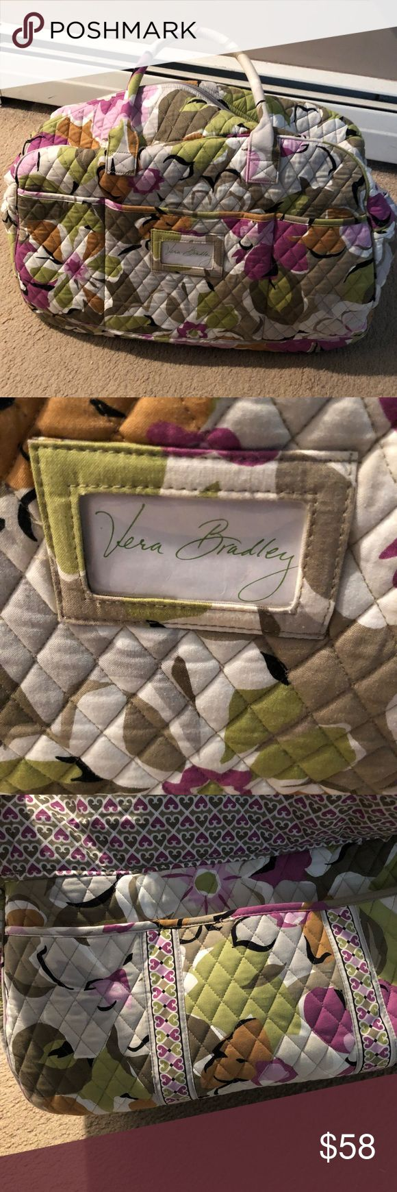 Vera Bradley travel Great Vera Bradley travel tote. Has plenty of wear left Ben used a handle of time. Taken care of and in good condition. Great color and good for those spring break or weekend get away Vera Bradley Bags Travel Bags