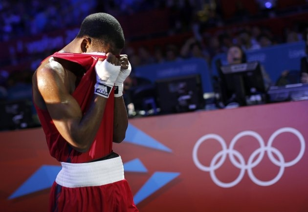 Jamel Herring of the U.S. reacts as he leaves the ring after losing to Kazakhstan's Daniyar Yeleussinov in the Men's Light Welter (64kg) Round of 32 boxing match during the London 2012 Olympic Games July 31, 2012. (REUTERS/Murad Sezer)