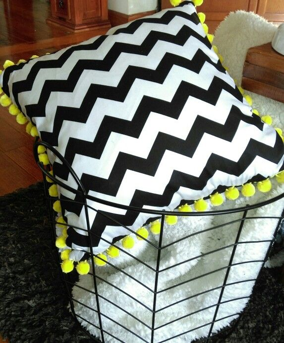Black chevron and yellow pompom cushion