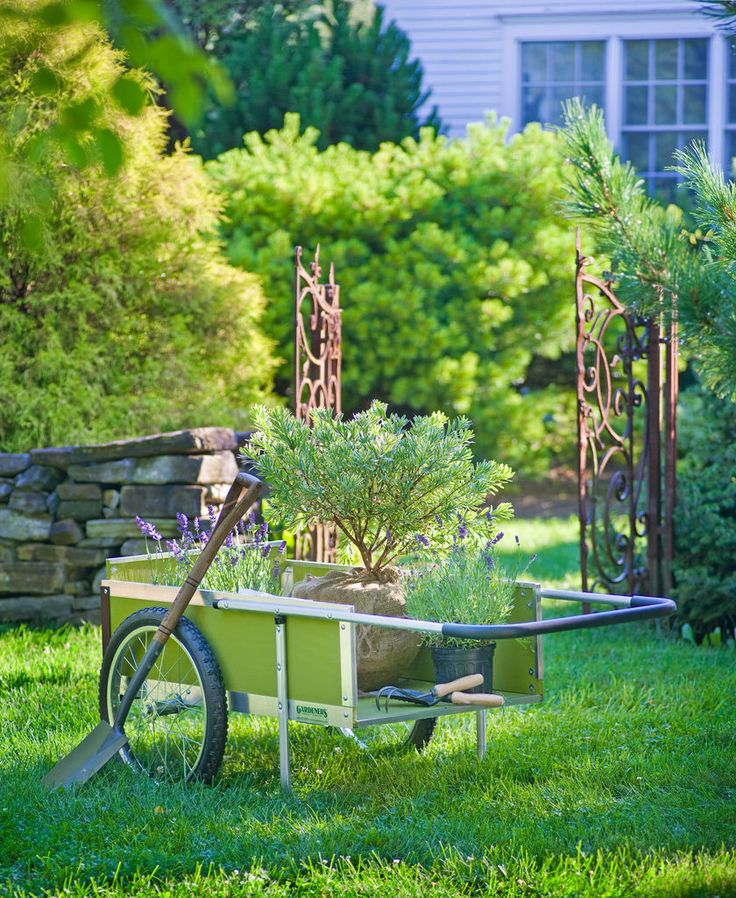 """Medium Garden Cart     For over 25 years, our garden carts have been a beloved tool of gardeners everywhere. That's because they were designed specifically to meet the needs of gardeners, not adapted from an industrial utility cart. Once you own one of our carts, it's hard to imagine getting by without it. Rated """"Excellent"""" by a leading consumer magazine."""