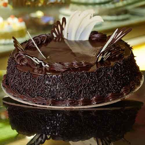 For a chocolate lover… Rich chocolate sponge layers filled with cherry cream and chocolate truffle #Chocolatecakes #Birthdaycakes #Photocakes visit us: www.cakepark.net Call us: 044-4553553