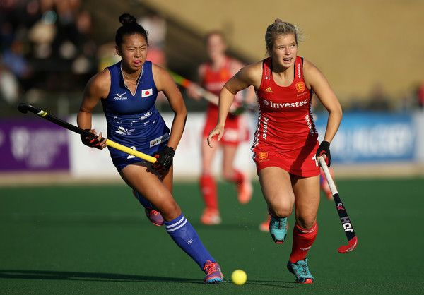 Sophie Bray of England and Yu Asai of Japan battle for possession during day 3 of the FIH Hockey World League Semi Finals Pool A match between Japan and England at Wits University on July 12, 2017 in Johannesburg, South Africa.