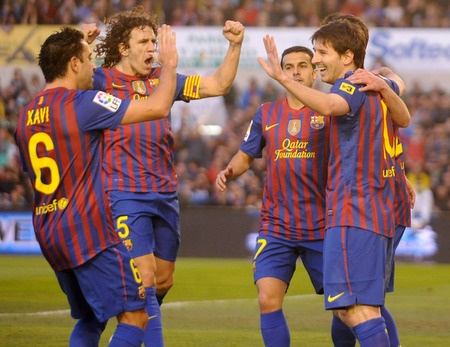 Barça players celebrating a goal. Fc Barcelona's aim in La Liga: not to lose any match