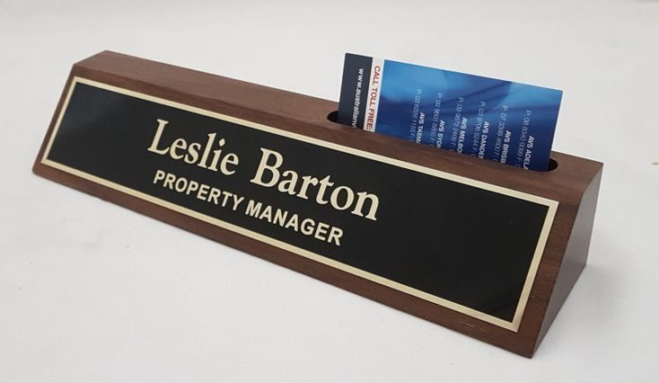 Walnut desk bar business card holder $49.50   Solid walnut timber desk bar, with top slot to hold business cards.    Size 255mm x 45mm    Available with either a Silver or Gold laser plate, or a Black and Gold metal nameplate.
