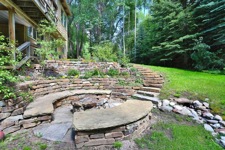 Traditional Landscape/Yard with exterior stone floors, Fire pit, Zoysia Sod 500 sq. ft. = 1 Pallet, Pathway, Raised beds