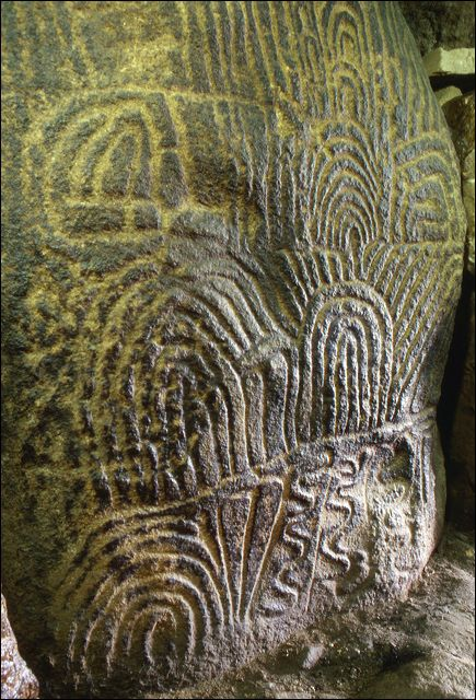 Carved Stone 8 in Gavrinis Dolmen passage grave, Gulf of Morbihan Larmor-Baden, Morbihan, Breizh. Cairn de Gavrinis Passage Grave, the largest and most decorated tomb in Neolithic Europe with 29 six-foot-high menhirs carved with labyrinthine fingerprints. This sanctuary /tomb/shrine was used by the same family for hundreds of years