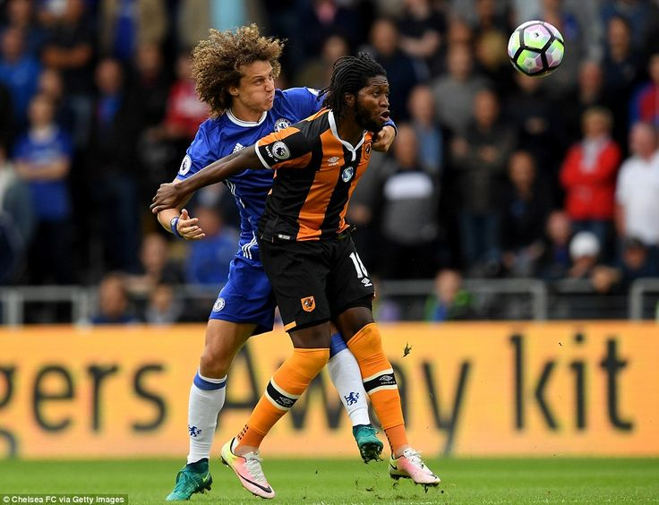 Brazilian centre back Luiz gets physical as he battles for the ball with Hull strikerDieumerci Mbokani