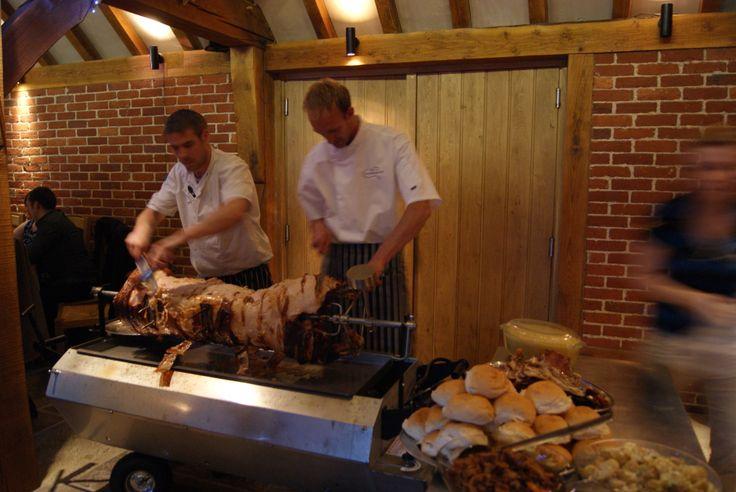 Hog Roast Being Served in The Barn at a Wedding Reception. www.theferryhouseinn.co.uk