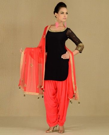 Black Suit with Bejewelled Neckline | Exclusively.in -- this is my favorite style right now: the short tunic with long sleeves, accompanied by the patiyala/harem pants. This color combo is fantastic as well.