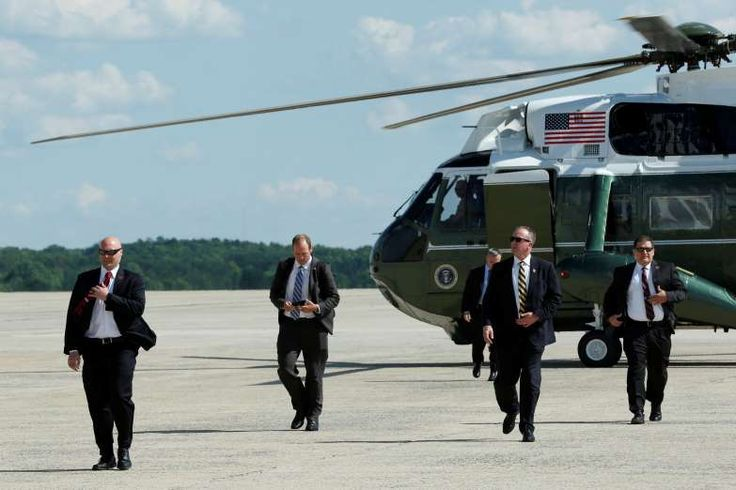 President Trump's Secret Service:  Secret Service agents arrive at Joint Base Andrews on a backup helicopter following President Donald Trump before his travel to Bedminister, N.J., on June 9, 2017.