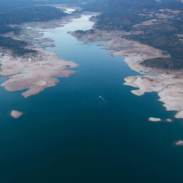 An #aerial view of Folsom Lake which is at 29 percent of its capacity. The lake is the sole source of water for #Folsom California a Gold Rush outpost near #Sacramento. As Folsom Lake approaches historically low levels it stands as one of the most disturbing symbols of the four-year #drought that has gripped the state. @damonwinter photographed the lake from above while on #nytassignment. by nytimes
