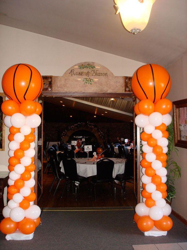 basketball party ideas | Giant basketballs atop classic columns tip of a fun banquet