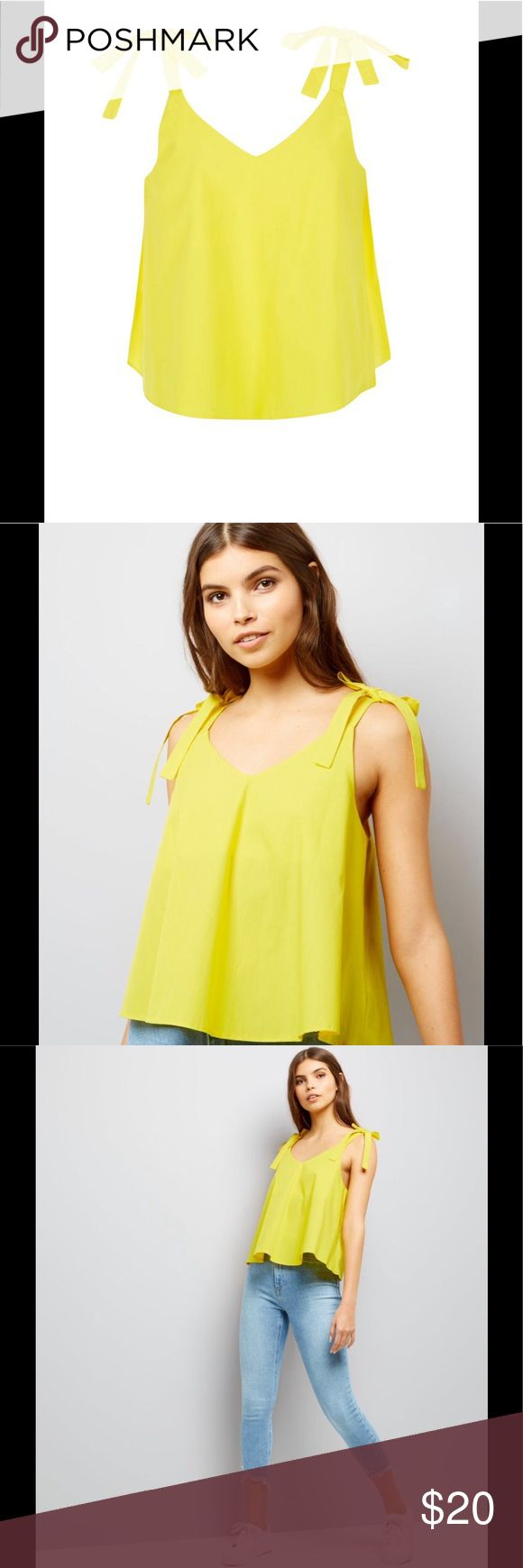 Yellow Cami Top Strap tie cami top. Very light and great for the summer. New Look Tops Camisoles