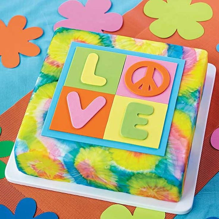 Get a taste of the 1960s spirit of peace, love and art! This cake uses Color Mist? Food Color Spray to create a groovy tye-dye effect on the cake, making it look like it just came from the 1969 Woodstock Music Festival!