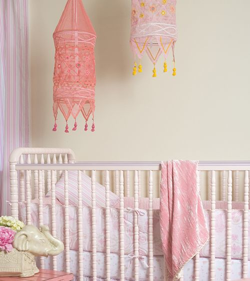 These lightweight gauze lanterns (without the lamp) are lovely for adding a soft touch of the bohemian to your nursery. #mobile #nursery