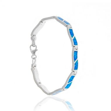 A 925 fine silver bracelet featuring blue opal gems set in nine wavy carved silver links. A delicate and graceful piece of silver jewellery which will surely grasp everyone's attention. This sterling silver bracelet is so delicate that you can match it with similar delicate blue opal silver bracelets from our collection. Carry always with you a piece of the magical blue colour of the Aegean sea. Match it with a blue opal sterling silver necklace to create varying elegant looks.