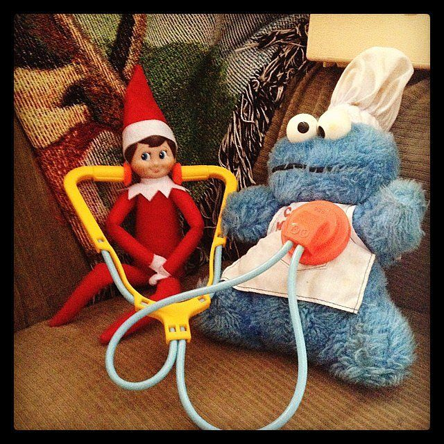 Instagram's lizbrownlee put her elf to work, giving some medical attention to Cookie Monster.   Source: Instagram user lizbrownlee