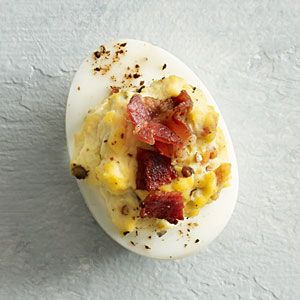 Bacon and Blue Cheese Deviled Eggs | MyRecipes.com  This is the best recipe and the fat cut with canola oil mayo, gotta try this!