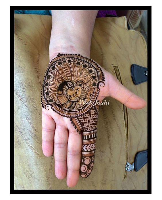 Best Peacock Mehndi Designs - Classical Indian Mehndi designs have a few elements which are much loved, traditional, yet unique in their rendering over the passage of time. These include tikkas, mango motifs, florals and peacocks.