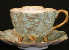 PAIR OF T.V. LIMOGE TEA CUPS AND SAUCERS