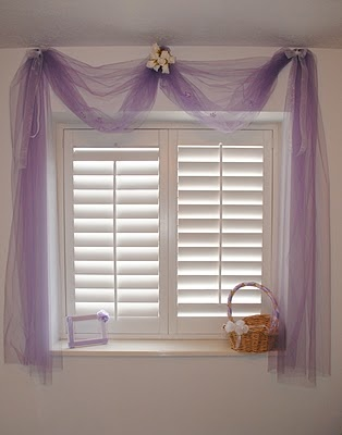 Tulle curtains... Cute for a little girl's room!