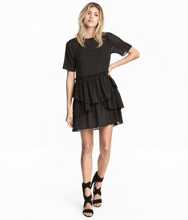Nearly black. Short dress in airy, crinkled cotton fabric with eyelet embroidery. Short sleeves, opening at back of neck with covered button, and seam at