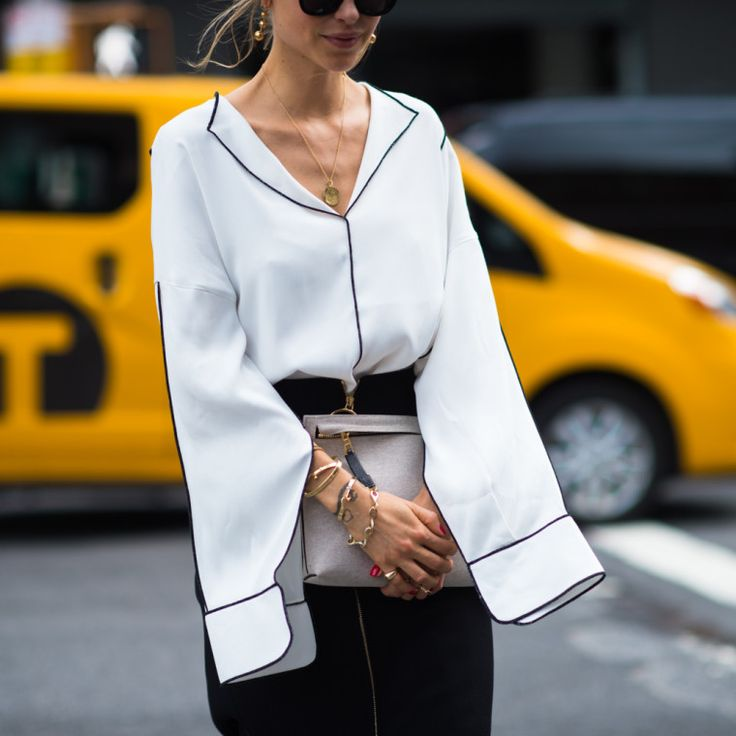 Extra-long sleeves are a runway trend that is now dominating the streets. While they add volume and drama to any look, we can't imagine they work so well when you're trying to text. Perhaps they're great for hailing cabs, though? Here, the best looks.