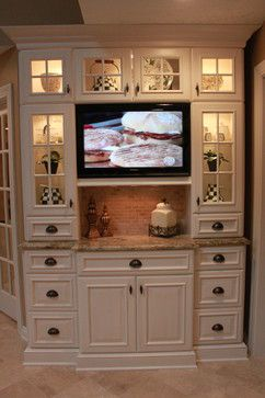 I like where the TV is placed in this kitchen. Broadview Heights Kitchen traditional kitchen